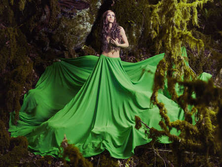 fairy forest: Beautiful nymph in the fairy forest. Fashion photo Stock Photo