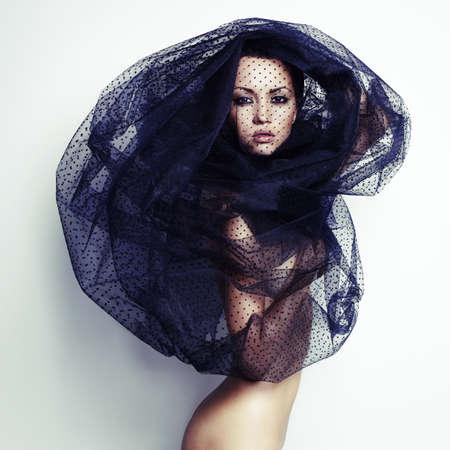 Sensual beautiful woman under the black veil Stock Photo - 21410438