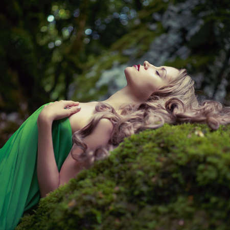coniferous forest: Portrait of elegant woman with luxurious hair in a coniferous forest