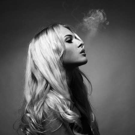 Fine art portrait of a beautiful lady smokes photo