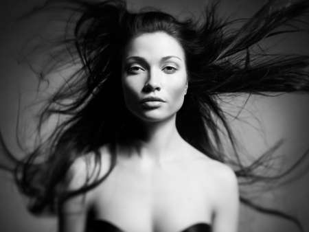 Black and white art portrait of a beautiful young lady photo