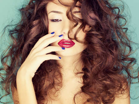 fine art portrait: Photo of young beautiful woman with red lipstick