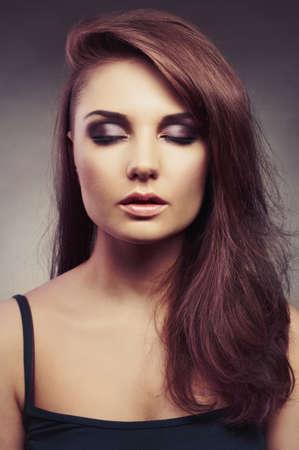 Fashion photo of young beautiful brunette lady Stock Photo - 22475648