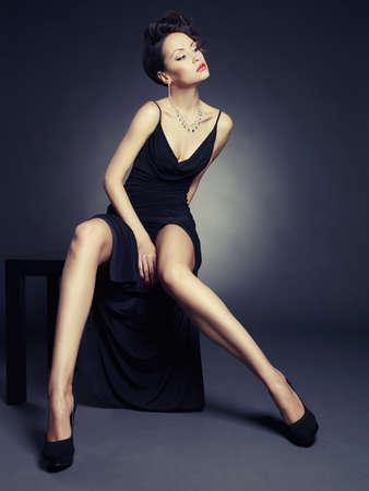 Fashion photo of beautiful lady in elegant evening dress Stok Fotoğraf