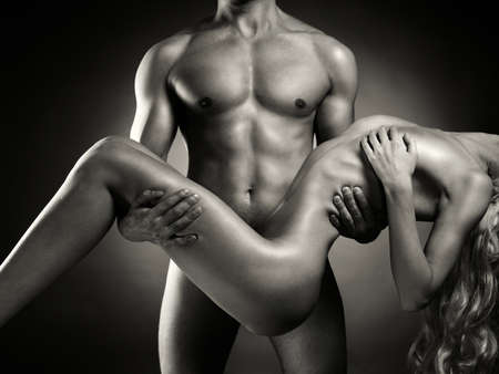 nude: Fashion art photo of nude men with woman in his arms Stock Photo