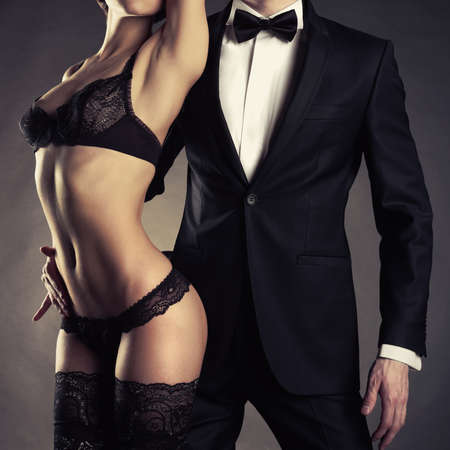 Art photo of a young couple in sensual lingerie and a tuxedo photo