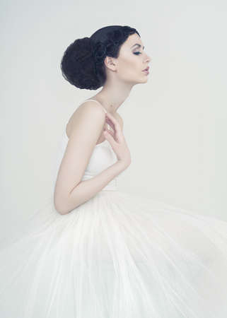 Portrait of beautiful elegant ballerina on white background Фото со стока