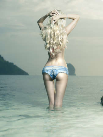 Beautiful slender blonde at the sea. Summer travel photos photo