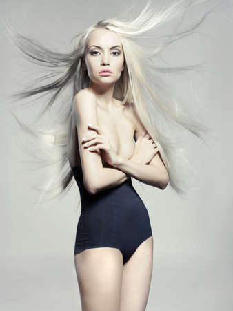 Fashion portrait of elegant woman with luxurious hair
