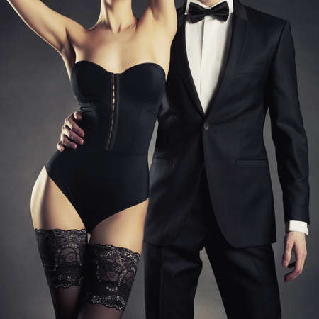 Art photo of a young couple in sensual lingerie and a tuxedo Stock fotó