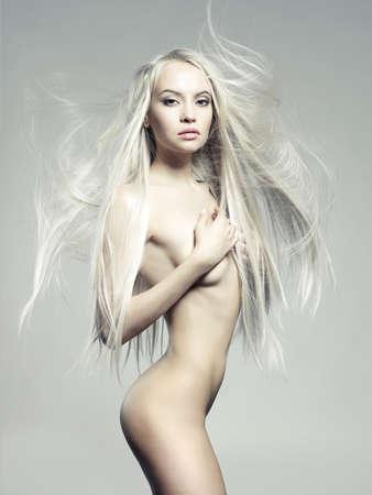 Studio fashion photo of elegant naked lady photo