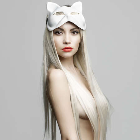 Fashion photo of beautiful sexy blonde in mask photo
