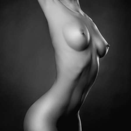 Fashion portrait of nude elegant lady on black background photo