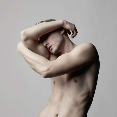 Fashion photo of naked male with strong body photo