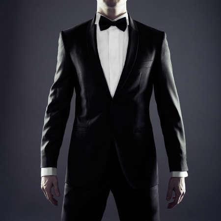 Photo of stylish man in elegant black suit photo