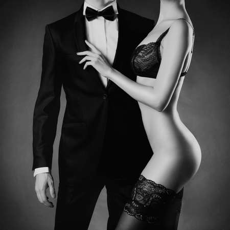 Art photo of a young couple in sensual lingerie and a tuxedo Фото со стока - 29240472