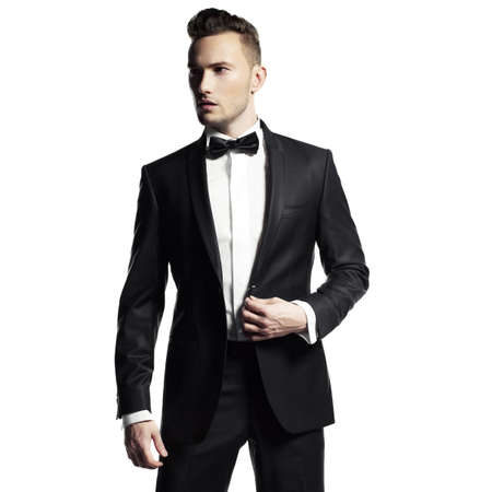 Portrait of handsome stylish man in elegant black suit