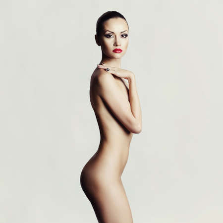 Studio fashion photo of elegant naked lady