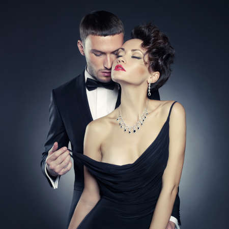 erotic sex: Fashion photo of sexy elegant couple in the tender passion
