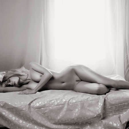 Fashion portrait of nude sensual woman in bed