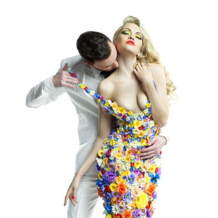 Fashion photo of young man and beautiful lady in flower dress Standard-Bild