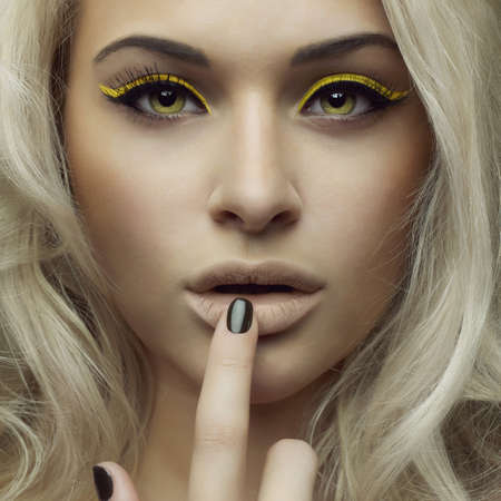 Fashion photo of beautiful woman with bright makeup photo