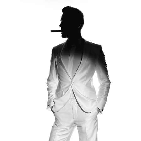 Concept photo of handsome stylish man with cigar