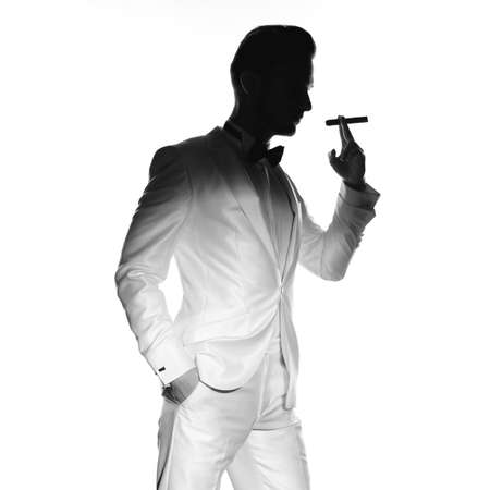 Concept photo of handsome stylish man with cigar photo