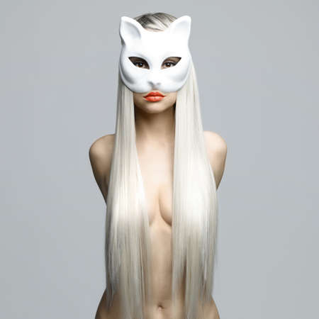 Fashion photo of beautiful sexy blonde in cat mask 스톡 콘텐츠