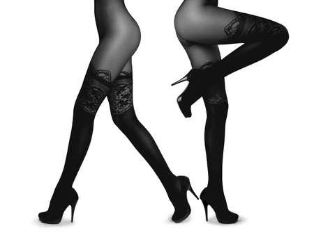 Slim female legs in pantyhose solated on white. Conceptual fashion art photo photo