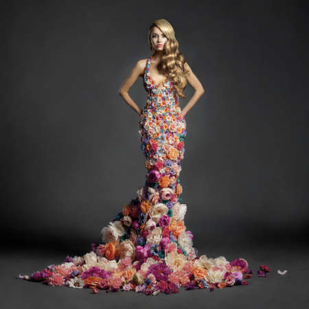 blooming: Studio portrait of blooming gorgeous lady in dress of flowers