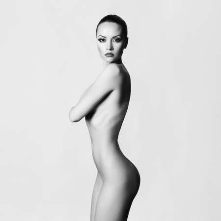 nude female buttocks: Studio fashion photo of elegant naked lady