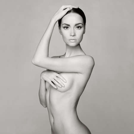 black and white studio photo of elegant naked lady Stock Photo