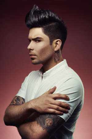 tatoo: Portrait of handsome man with stylish haircut