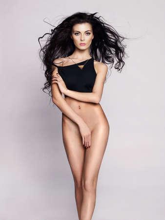 Fashion art photo of elegant naked lady with long hair