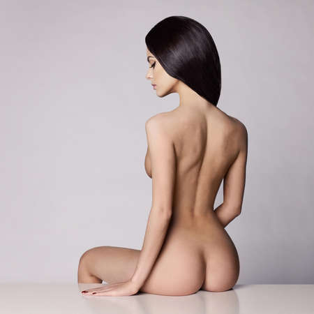 Fashion art studio photo of elegant naked lady Stock Photo
