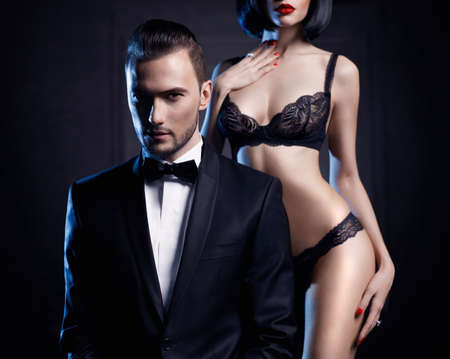 sexy naked woman: Fashion studio photo of a sensual couple in lingerie and a tuxedo
