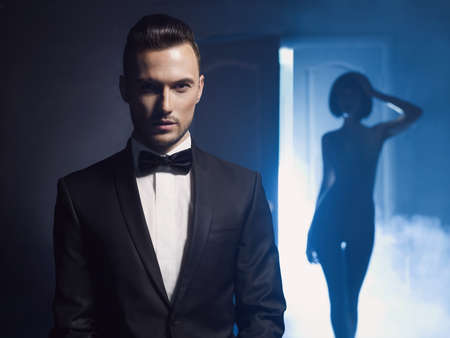 Fashion studio photo of a sensual couple on black background