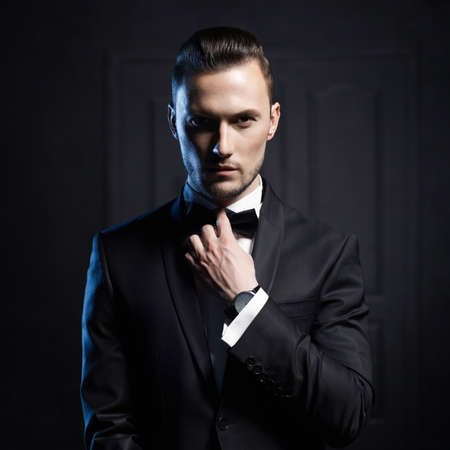 1 man only: Portrait of handsome stylish man in elegant black suit