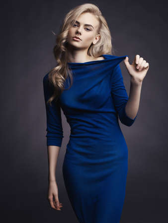 woman dress: Studio fashion photo of elegant beautiful lady in blue dress