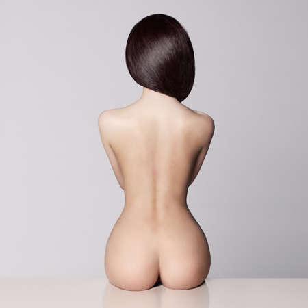 naked woman back: perfect female body with beautiful nude booty Stock Photo