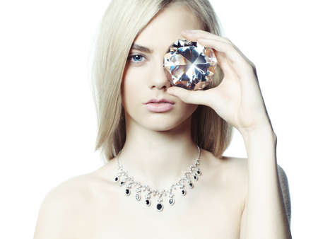 diamond ring: Studio fashion portrait of young beautiful lady in jewelry Stock Photo