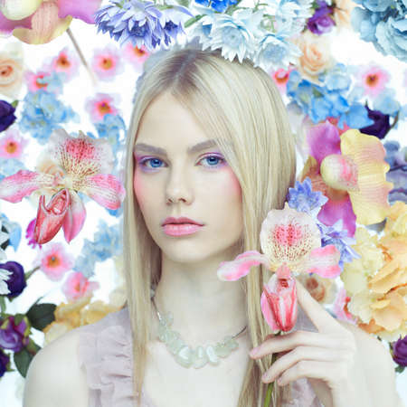 light complexion: Fashion art portrait of beautiful lady in delicate flowers around