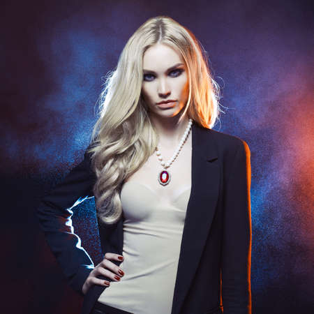 decolette: Studio fashion portrait of young beautiful lady on black background Stock Photo