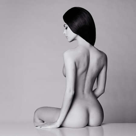 nude woman sitting: Fashion art studio photo of elegant naked lady Stock Photo