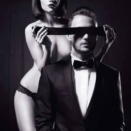 nude wife: Fashion studio photo of a sensual couple in lingerie and a tuxedo