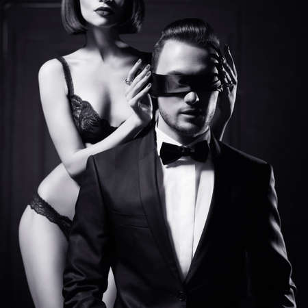 sex couple: Fashion studio photo of a sensual couple in lingerie and a tuxedo