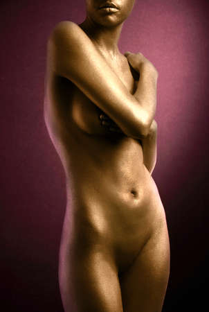 naked statue: elegant body-art. Nude woman with gold skin Stock Photo