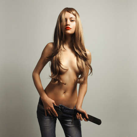 woman nude standing: Fashion photo of young sensual woman in jeans