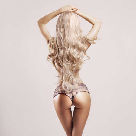 nude back: Fashion portrait of beautiful sexy blonde in jeans short